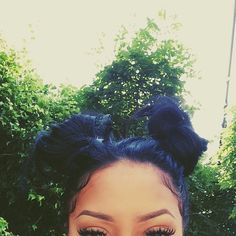 twin buns & big lashes.