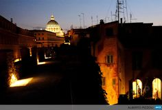 ITALY, Rome: Visitors walk at sunset in The Passetto di Borgo in Rome on July 24, 2013. Only open for a few months in the summer, the Passetto di Borgo is an elevated passageway some 800 metres in length that passes evocatively above the bustle of the everyday world as it runs along the top of the walls that used to surround and protect the Leonine City, connecting the Castel SantAngelo to the Vatican City. The walkway was added to the wall so that the Popes could reach their private…