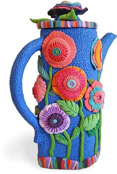 Florida's Pamela Carman makesa flowery potof tea on a spring Monday. A visit to her Flickr site shows you the vases, bottles, pots, birdhouses and fish shapes that she covers with polymer. Usually she uses hundreds of slices of small canes to [...]