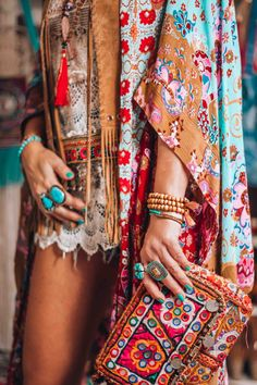Love the colors & patterns & the turquoise jewelry.