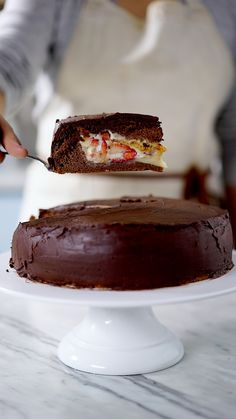 Filled with a rich strawberry cream concoction and topped with decadent chocolate icing, this cake will give you all the dessert feels. Bonbon Cake Recipe, Sweet Recipes, Cake Recipes, Dessert Recipes, Decadent Chocolate, Chocolate Icing, Food Porn, Tasty, Yummy Food