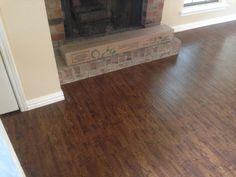 Undercut Fireplace with laminate floor.