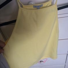 Yellow Crop Top New with tags from Charlotte Russe size large really cute crop top Charlotte Russe Tops Crop Tops