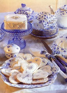 This is a beautiful tea setting complete with cookies.