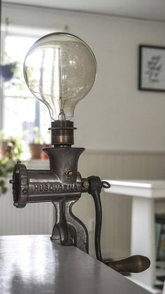 Handmade lamp made from an old meat grinder. Swedish vintage meat grinder from Husqvarna probably from the 1920s. E27 socket for light bulb. Hemp cord, Swedish/European plug. Lightbulb not included. I have collected old and rusty things for as long as I can remember. There is