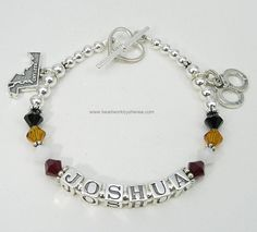 Sterling Silver & Swarovski crystal bracelet with Maryland State, and Handcuff charms to commemorate Joshua's graduation from the Maryland State Police Academy.