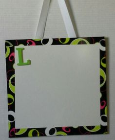 Great idea for kids craft project! Showerboard cut into foot square. Duct tape or patterned packing tape with a foam initial. Doing this as a craft project for junior camp this year.