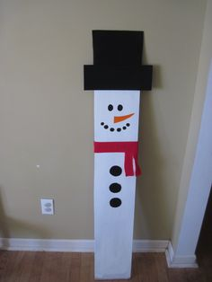 Snowman on wood board I found in my garage.  Just paint his face in and add felt for hat, scarf and buttons using a glue gun.