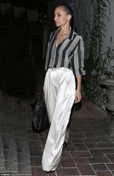 Nicole Richie flashes her black bra under revealing semi-sheer blouse #dailymail