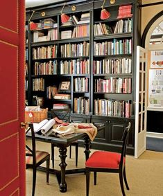 ebonized shelving, galerie des lampes sconces, upholstered red doors with nailheads