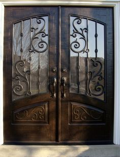 Double Front Entry Doors - Rec Top - Orleans Panel Design - Finished in Rustic Distressed Walnut. 678-894-1450 www.masterpiecedoors.com