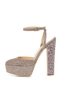 Glam Sergio Rossi pumps in a glitter-coated weave. Wraparound ankle strap with buckle closure. Chunky, covered platform and heel. Leather sole.