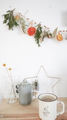 Diy dried citrus and winter greenery garland for the holiday season.