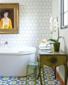 diy bathroom décor white subway wall tiles and colorful blue yellow and white floor tiles in a room containing a white tub a framed painting and boho chic furniture Yellow Bathroom Decor, Yellow Bathrooms, Cheap Bathrooms, Bathroom Wall Decor, Bathroom Flooring, Amazing Bathrooms, Diy Bathroom Vanity, Boho Bathroom, Ikea Bathroom