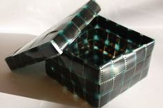 A box made out of recycled film: (photo strip, photography, negatives, projects, crafts, DIY, do it yourself, interior design, home decor, easy, fun, cheap, ideas, inspiration, reduce, reuse, recycle, used, upcycle, repurpose)