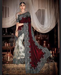 Maroon and light grey half and half sari with heavy zari and resham embroidery   1. Maroon and light grey net satin silk half and half heavy embroidered sari2. Golden zari resham and sequins heavy embroidered pleats and border3. Comes with matching unstitched blouse4. Can be stitched up to size 42 inches