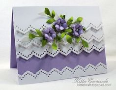 Layers of Eyelet Borders with flowers in purple by Kittie Caracciolo