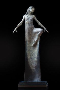 """London-based artist Michael James Talbot creates beautiful sculptures of elongated women inspired by Greek mythology and Venetian masquerades. The surreal representations merge the human form with abstract and exaggerated shapes, most often presenting a visual extension of the female's garment. Altogether the sculptures stand tall, some even reaching heights greater than 6 feet tall."""