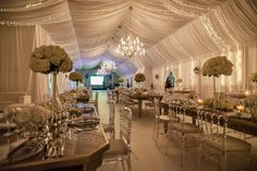 White wedding reception. Wedding Reception, Chandelier, Ceiling Lights, Table Decorations, Home Decor, Wedding, Homemade Home Decor, Candelabra, Chandeliers