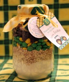 Cute idea.  A birthday party favor you can do for not too much $.  They used these jars and made tags and gave the guests these John Deere cookie mixes.