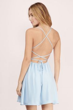 Dance to the beat in the Sonya Strappy Skater Dress. This skater dress features a v-neck and a strappy open back. Wear with sandals and fun jewelry.