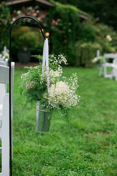 Outdoor Ceremony Potted White Flowers Gypsophila Silver Tin White Ribbon Floral Arbour Flower Farm Outdoor Wedding Minnesota http://eileenkphoto.com/