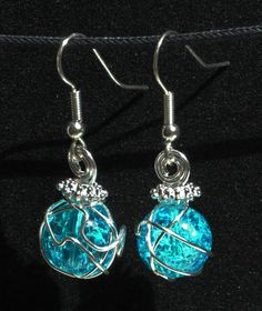 Silver earrings with wire wrapped blue glass crackle beads and looped top