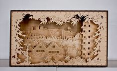 The box is made of birch plywood and veneer, laser cut, the five landscape layers are sewn into the wooden box with leather lace. Internal LED-lights. 70x30x40cm