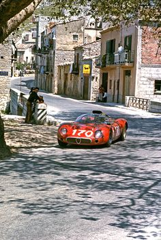 Andrea de Adamich and Jean Rolland's Alfa Romeo T33 racing in the 1967 Targa Florio in Sicily.