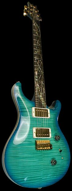 PRS Custom 24 Tree of Life, Makena Blue. God I want one of these so bad. Only 50 made of each color (the other is brown, also super gorgeous). This guitar is breath taking.
