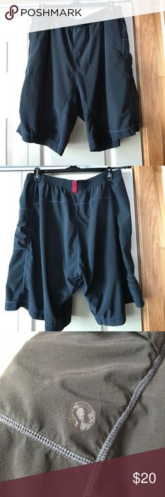 """Lululemon Men's gym shorts, Size Large Used condition, Lululemon Men's gym shorts, Size Large, charcoal grey color, 9"""" inseam, has a liner with large rips in it, comes from smoke free home lululemon athletica Shorts Athletic"""