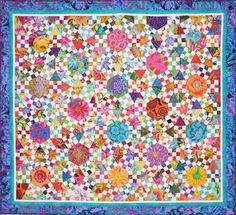 Lessa, Australian quilt designer = one gorgeous quilt! This site has several different color variations.