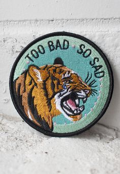 "Sometimes bad stuff happens, even to cool tigers.   3.5"" embroidered patch with merrowed edge and iron-on backing. $5"