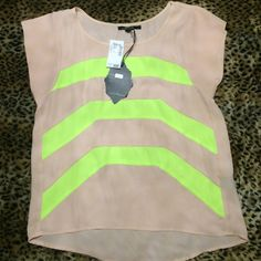 Beige and Neon Yellow Top ✨Loose fit.                                                              ✨Size medium.                                                      ✨NWT.                                                                                  ✨❤️GREAT HOLIDAY GIFT❤️✨.                      Lowest Price Unless Bundled Tops