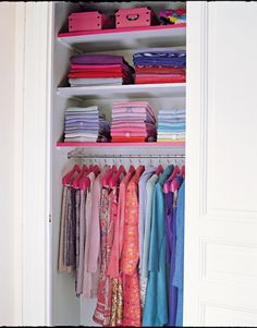 Sweaters folded and stacked as they would be in a retail store, and coordinated by color, work with colored hangers to make this closet a truly attractive composition. A door seems almost unnecessary.