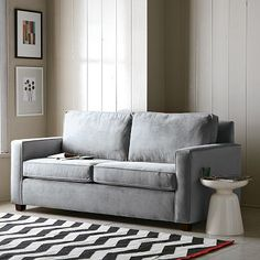 Can I pull off a gray sofa with so much brown in my LR? I like this light, stone white gray.