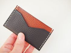 A simple, slim card holder. Has a two card slot, suitable for 2-4 cards. Please chose thread colour (Thread colour sample in the last picture) Approximate Dimensions: W 4.25 x H 2.75 W 10.5cm x H 6cm - 100% Vegetable tanned leather - Hand stitched with waxed thread - Edges are burnished to