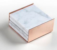 Inject some elegance into your home decor with a stack of marble + rose gold coasters.