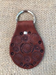 Excited to share this item from my shop: Flower Stamped Leather Keychain / Boho Leather Key Fob Leather Stamps, Leather Art, Sewing Leather, Diy Leather Gifts, Leather Bags Handmade, Leather Crafts, Leather Tooling Patterns, Shops, Leather Carving