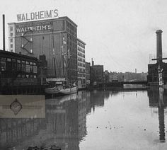 View looking north down the Milwaukee River toward the Waldheim's Furniture store building.