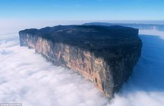 The breathtaking Mount Roraima, the highest of the Pakaraima chain of tepui plateau in South America, peaks above the clouds. Its 31sqkm sum...