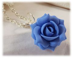 A handcrafted blue rose necklace available in colors of light sapphire, navy, cornflower and more. This little blue rose pendant is great for
