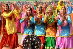 Gidha (Punjabi: ਗਿੱਧਾ, Pronounce: Gidhā) is a popular folk dance of women in Punjab region of India and Pakistan. The dance is often considered derived from the ancient dance known as the ri… Punjab Culture, India Culture, Saris, Salwar Kameez, Sharara, Salwar Suits, Desi, Indian Colours, Vibrant Colors