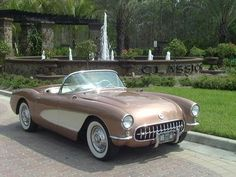 "Produced in the ""solid-axle"" generation of automobile manufacturing, this 1956 silver and white Corvette is the first generation of the sports car by the Chevrolet division of General Motors."