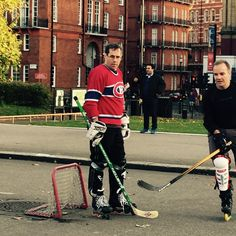 Canadians playing road hockey in London, England. I guess they couldn't find a bigger net.
