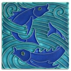 Turquoise cobalt fish tile made in Ann Arbor Michigan by Motawi Tileworks