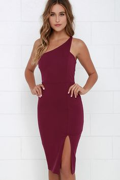 Burgundy One Shoulder Midi Dress and you can count on an unforgettable getaway! Burgundy stretch knit sweeps across the shoulder to a single tank strap alongside notched arm openings, and a darted bodice. Fitted waist and bodycon skirt create a seductive finale, complete with a slit at front. Hidden side zipper. Fully lined. Self: 65% Rayon, 30% Nylon, 5% Spandex. Lining: 100% Polyester. Hand Wash Cold. Made With Love in the U.S.A.