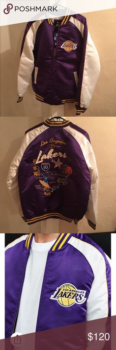 LA Lakers Starter Jacket This jacket is brand new with tags. The jacket was shipped from Urban Outfitters, damaged. A small slit on the left chest on the white part of the jacket. The damage is displayed in the last two pictures. The jacket is a glossy satin LA Lakers Souvenir jacket. Classic bomber silhouette offers a quilted lightweight, full - length from zip closure and striped rib - knit banding at the collat, cuffs, and hem. Lakers patch on the chest and elaborated LA themed…
