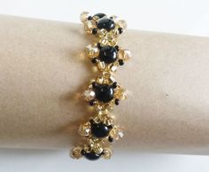 Gift idea. Birthday gift. Jewelry. Diamond Shaped Bracelet    Bracelet with golden coloured crystals, flat round beads and seed beads. lobster clasp. Length is 18.5 cm