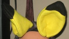 Pikachu fleece ears with metal snap hair clips to attach to your hair, hat or a headband.  Dimensions: 3.5 inches  Color: Black and yellow  Materials:
